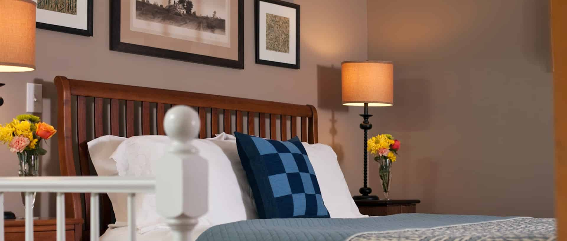 Dark blue striped bedspread with slate headboard