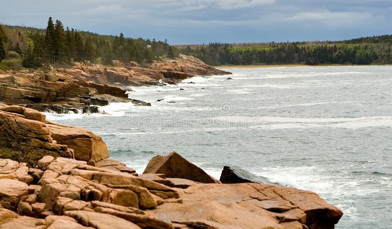Rocky coastal shoreline with ocean waves crashing