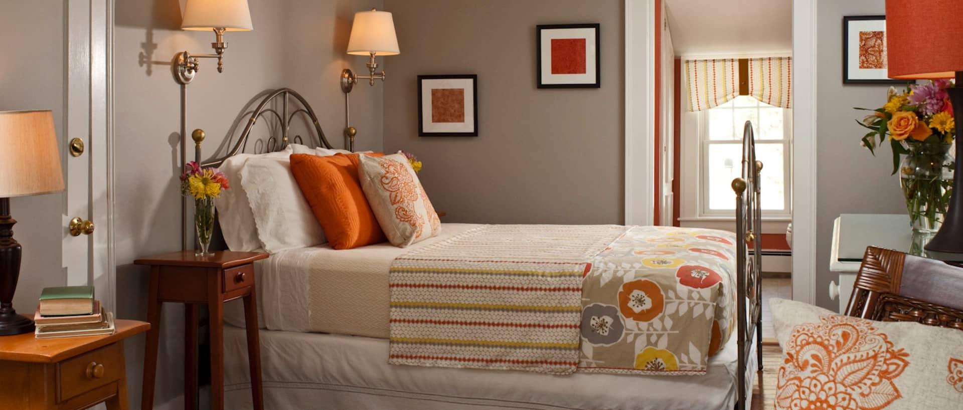 beige striped bedspread with flowers