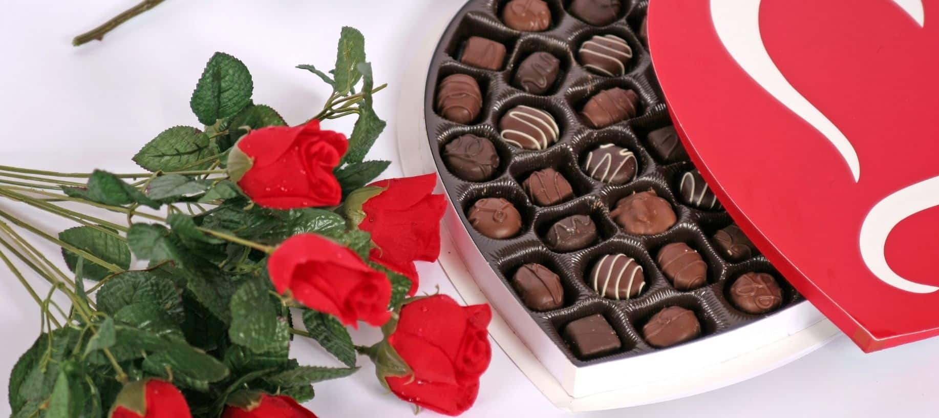 Heart shaped box with chocolates and red roses