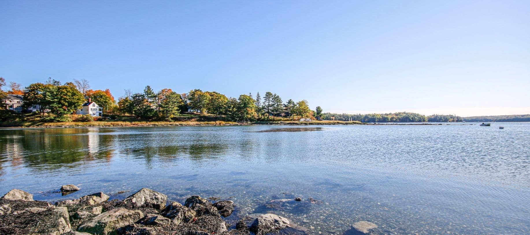 Damarascotta River in the fall with tree and rocklined shores