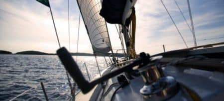 sails and winch on sailboat on the water