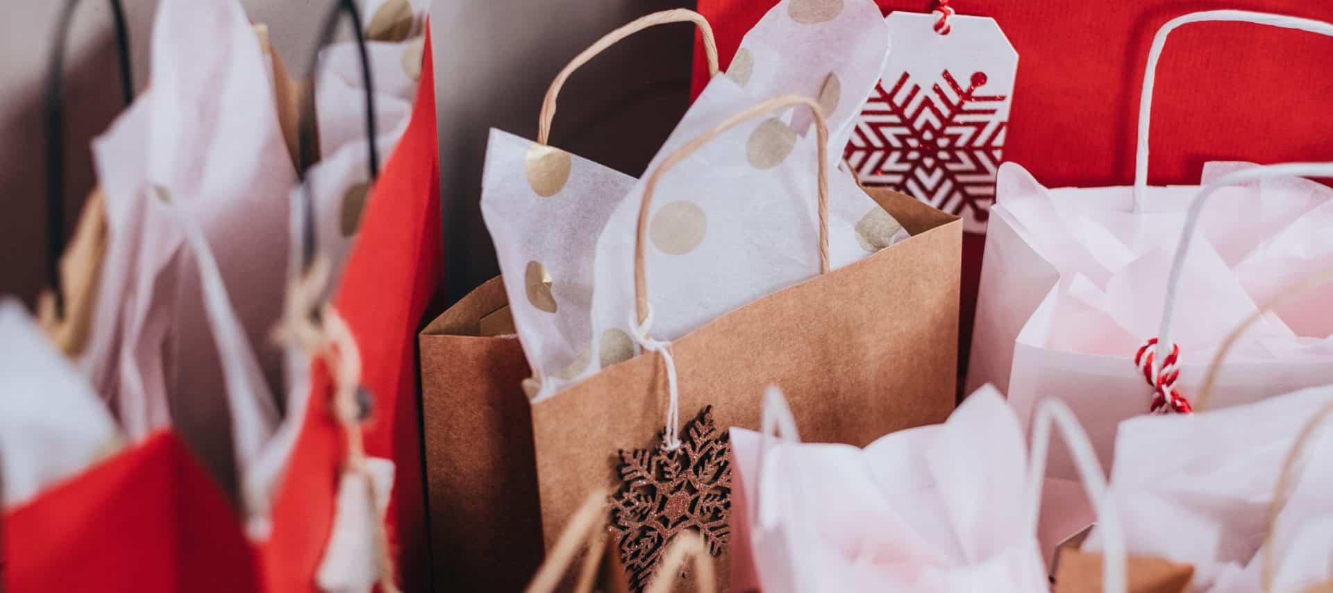 Several holiday shopping bags